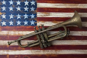 old-trumpet-on-american-flag-garry-gay